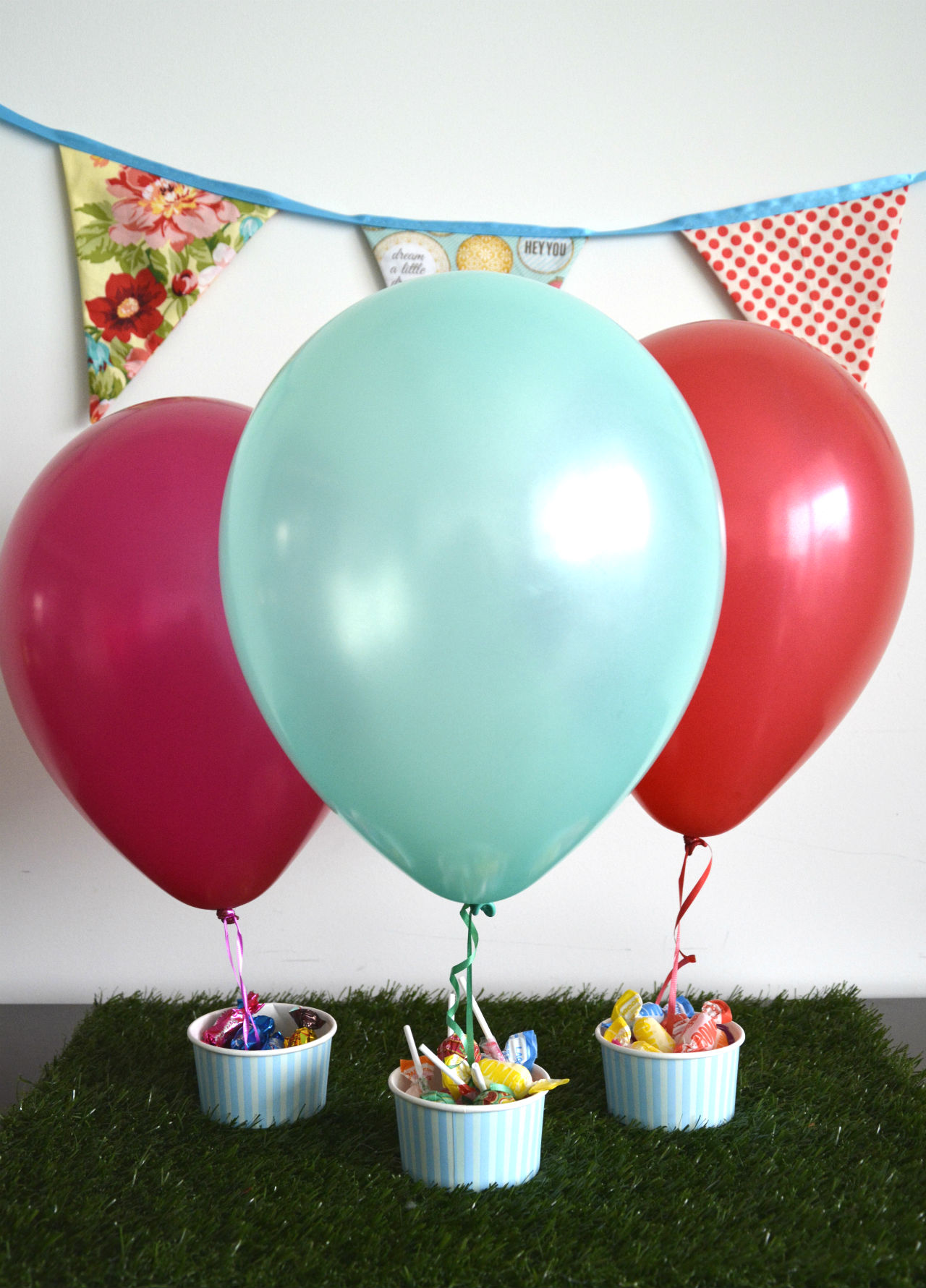 Diy hot air balloon centrepieces the party connection for Balloon decoration making